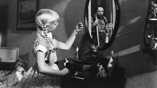 The Bad Seed (1956) Directed by Mervyn LeRoy Shown: Patty McCormack (as Rhoda), Henry Jones (as Leroy Jessup)